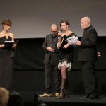 Director Ana-Felicia Scutelnicu on stage as she receives the CinemaXXI Award for Panihida, as host Claudia Pandolfi, jury member Douglas Gordon and Festival Director Marco Mueller